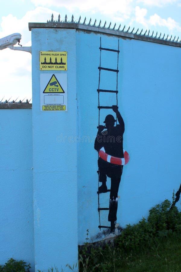 Grafitti för manklättringstege royaltyfria foton
