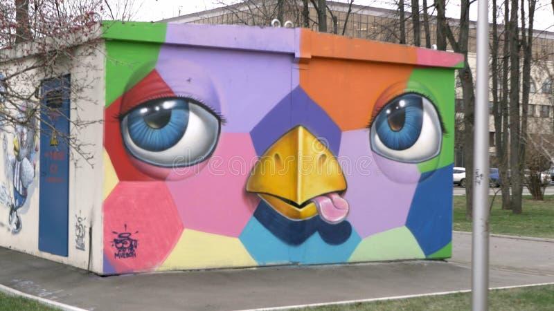 Grafitti med flaggor och tecknade filmer arkivfoto