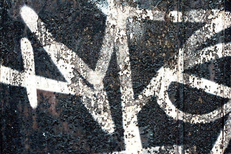 Grafitti på en vägg - detaljen av en grafitti målade på en vägg arkivbild