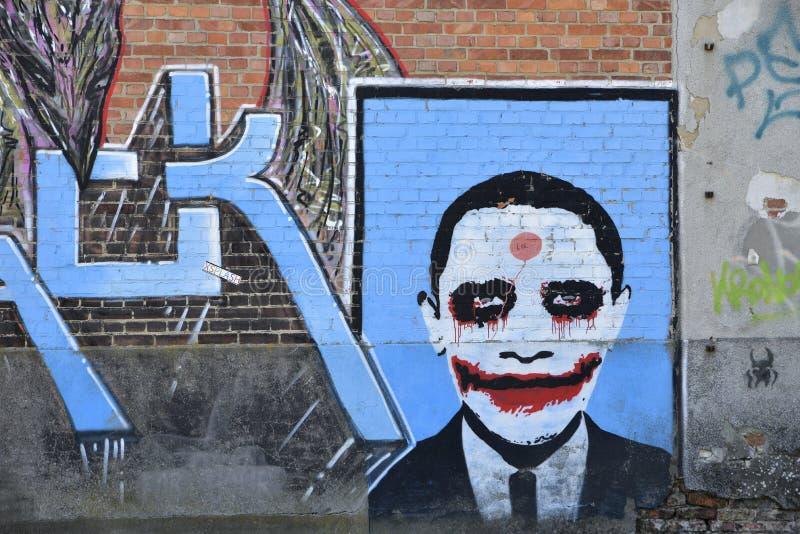 Grafitti på tegelstenväggen, Doel, Belgien fotografering för bildbyråer