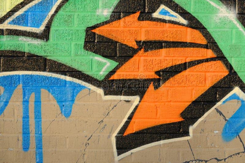 Grafitti wall. Grafitti painted wall with three orange arrows stock photo