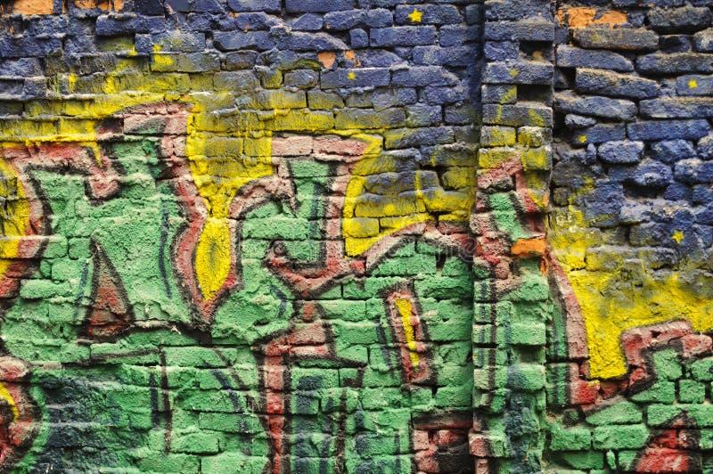 Grafitti wall. Colorful brick wall with grafitti stock image