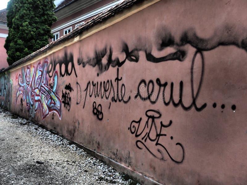 Grafitti on the wall. Grafitti on a wall in BraÈ™ov, Romania. BraÈ™ov is a city in Romania and the administrative centre of BraÈ™ov County royalty free stock images