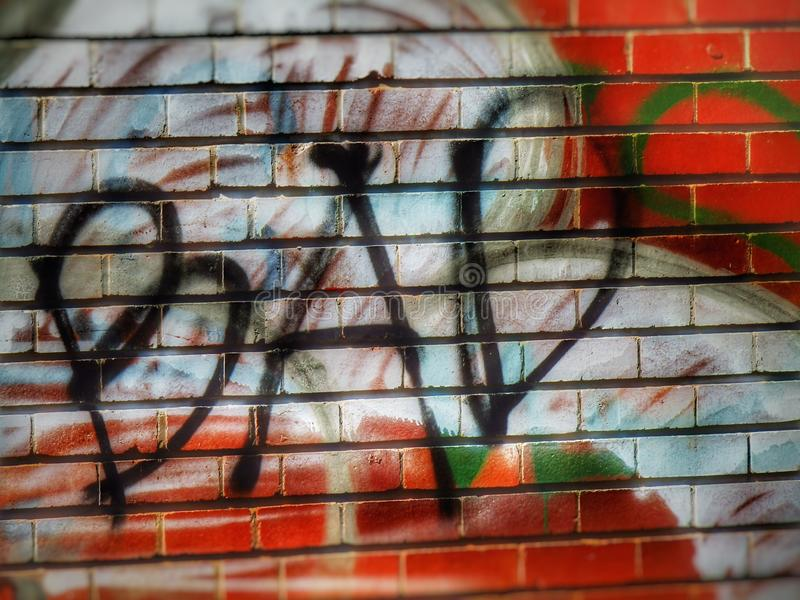 Grafitti on the wall. Bad, writing, art, , abstract, expression, spraypaint, culture royalty free stock image