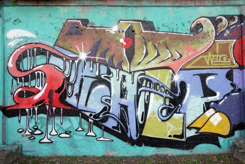 Grafittis da parede foto de stock