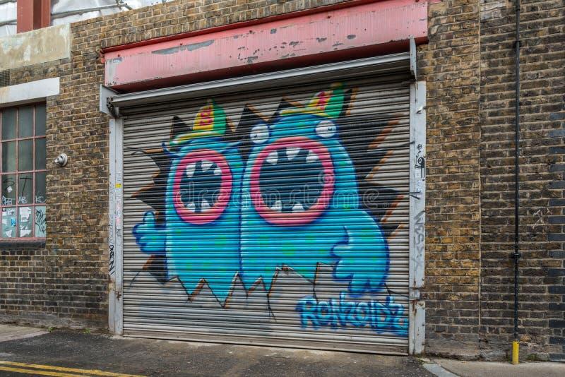 Grafittis da rua em Londres imagem de stock