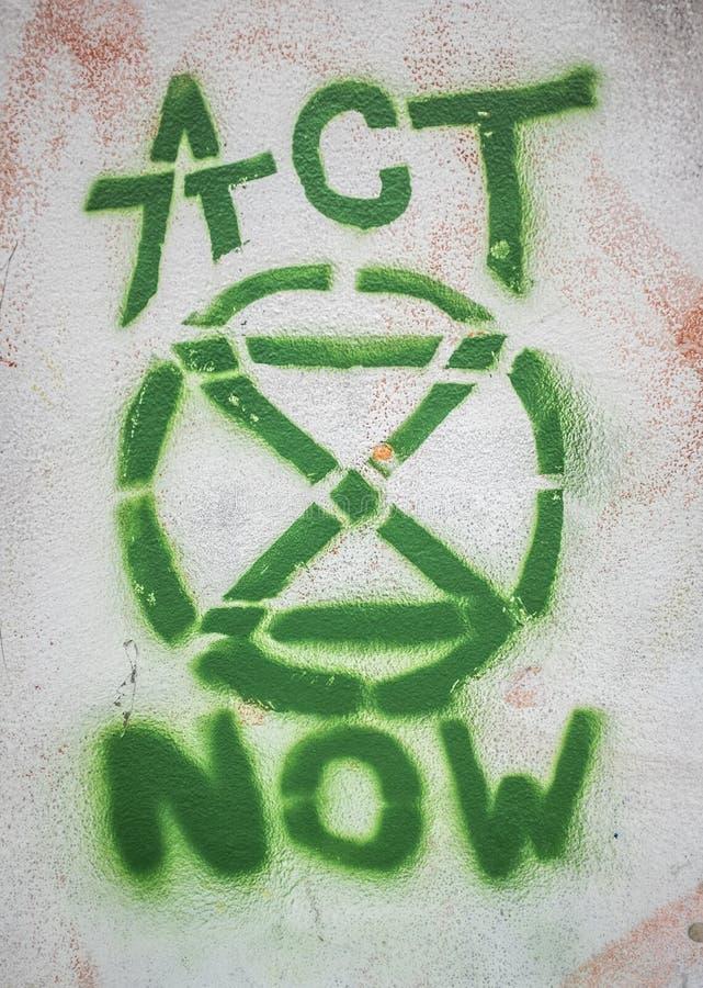 Grafittis do logotipo da rebelião da extinção fotos de stock