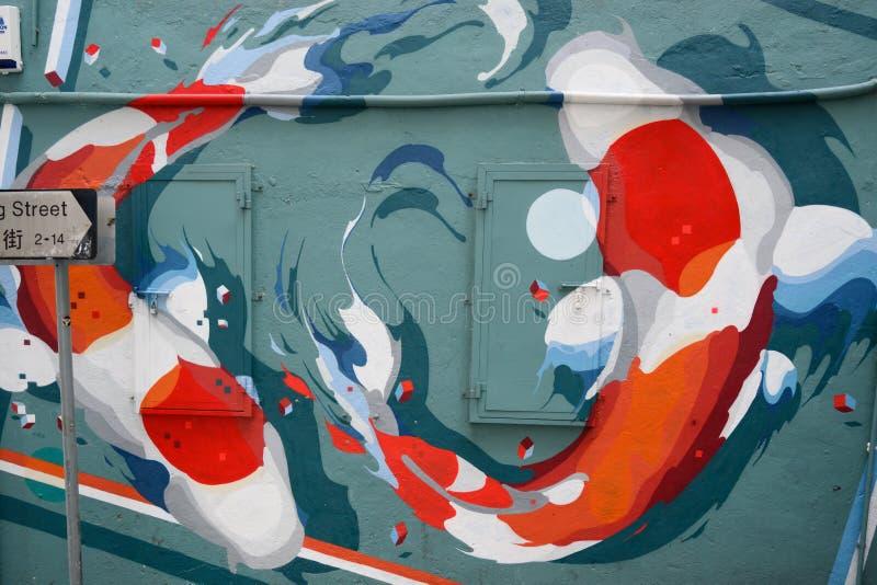 Grafittis, Kois que nada no círculo, estilo moderno da pintura de parede, Hong Kong, China fotografia de stock royalty free