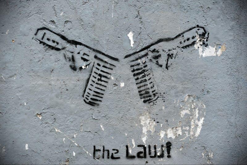Grafittis temáticos da arma imagem de stock