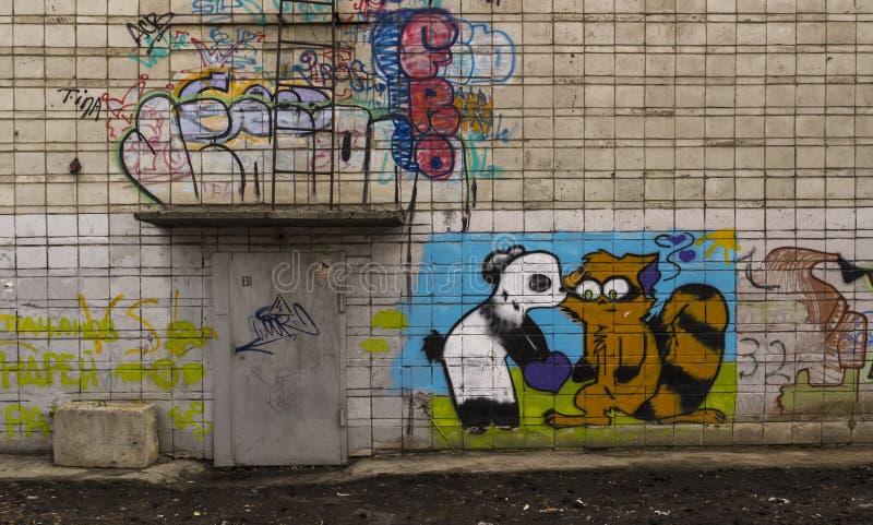 Grafittitvättbjörn och panda royaltyfri bild