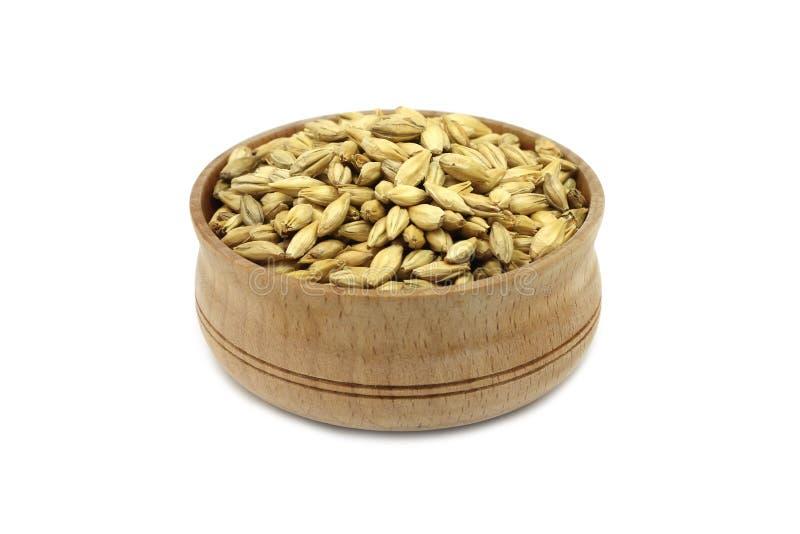 Grain barley malt in a wooden dish stock photo