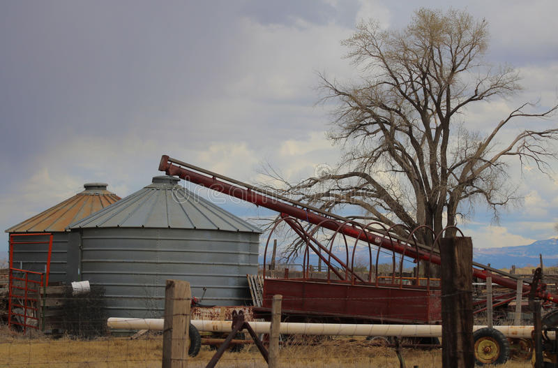 Download Grain bins and auger stock image. Image of clouds, farm - 86702159
