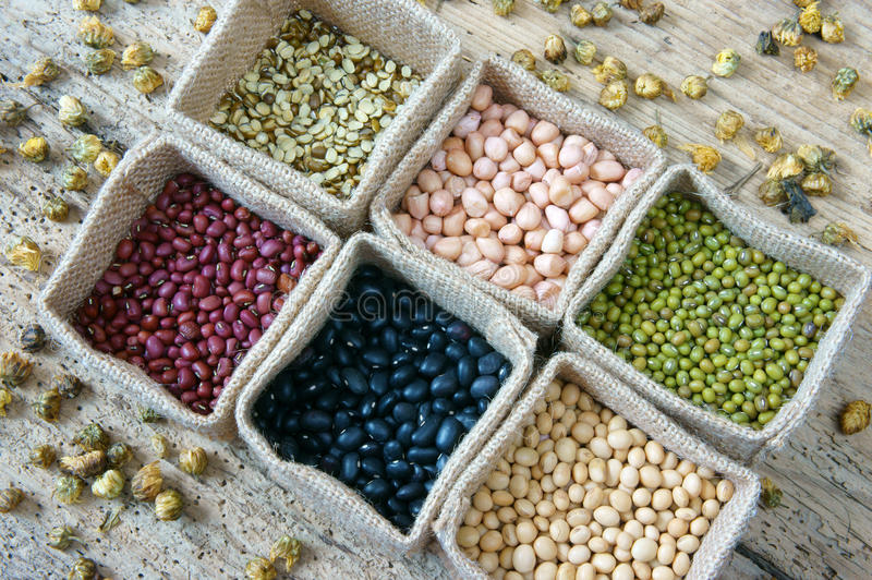 Grain, cereal, healthy food, nutrition eating. Collection of grain, green bean, red bean, soybean, black bean in bag, cereal product is healthy food, nutrition stock image
