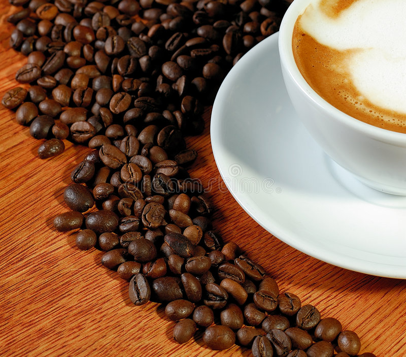 Grain of coffee. On wood table stock image