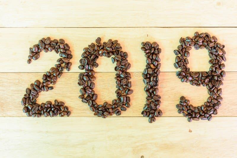 Grain de café avec le texte 2019 photos libres de droits