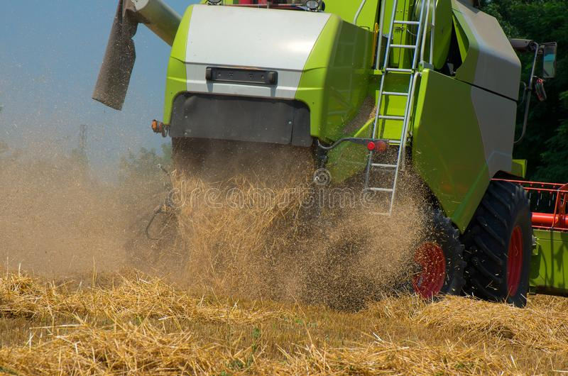 Grain harvesting with combine harvester stock images