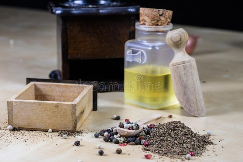A grain of pepper on a kitchen table. Ground pepper in a kitchen. Mill. Culinary spices on a light background stock photos