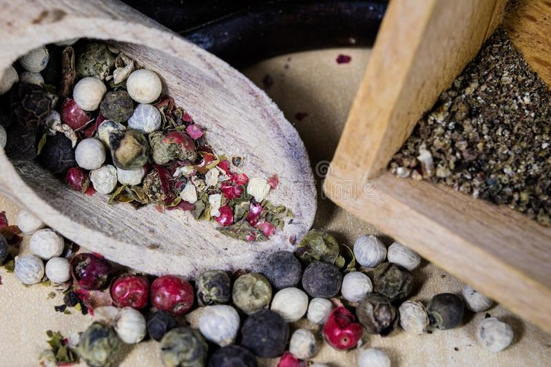 A grain of pepper on a kitchen table. Ground pepper in a kitchen royalty free stock photos