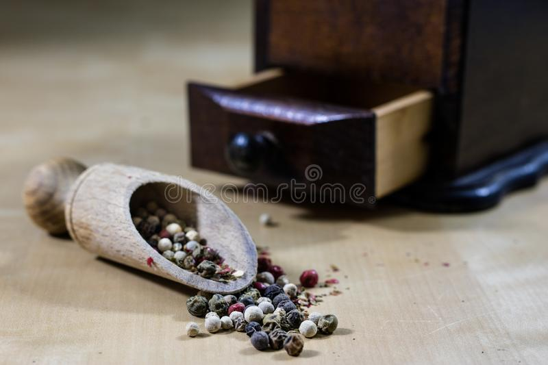 A grain of pepper on a kitchen table. Ground pepper in a kitchen royalty free stock image