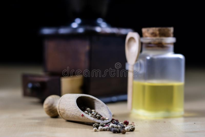 A grain of pepper on a kitchen table. Ground pepper in a kitchen stock photos