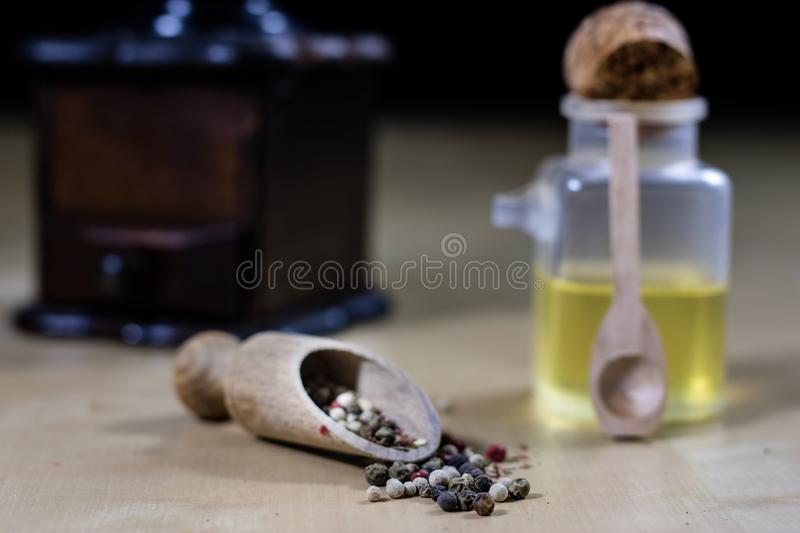 A grain of pepper on a kitchen table. Ground pepper in a kitchen stock photography