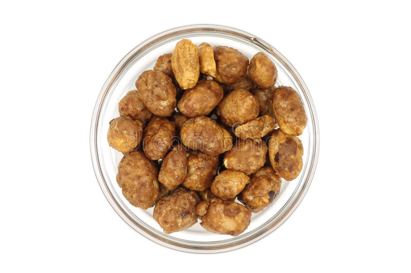 Grain roasted peanuts in a glass bowl stock photos
