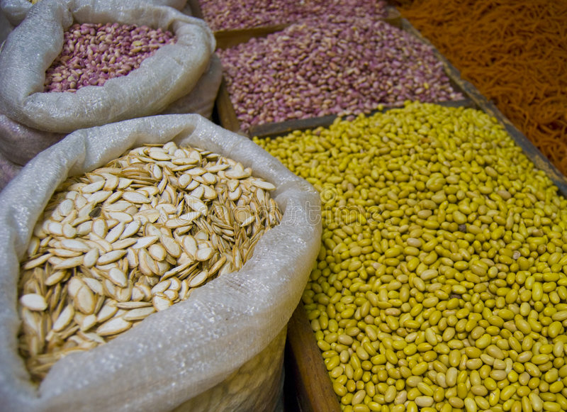 Grain and seeds. A small grain and seed stand inside a farmers market in a rural area of Mexico stock images