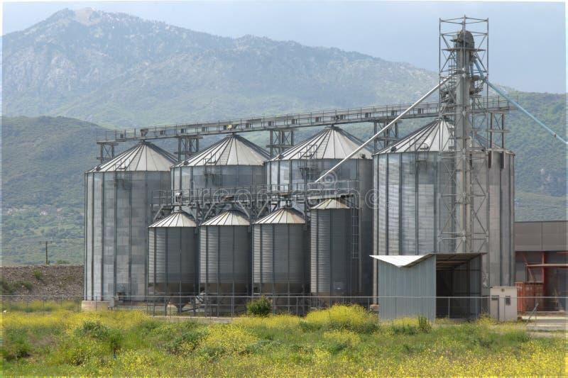 Grain silo plant unit dehydrate corps corn. Grain silo plant unit dehydrate agricultural store corps corn agricultural royalty free stock photo