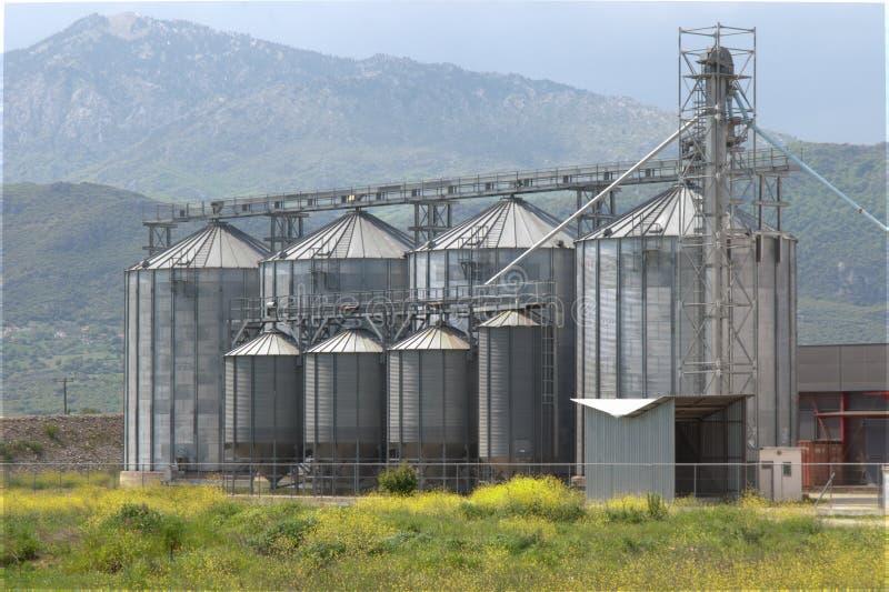 Grain silo plant unit dehydrate corps corn. Grain silo plant unit dehydrate agricultural store corps corn agricultural royalty free stock photos