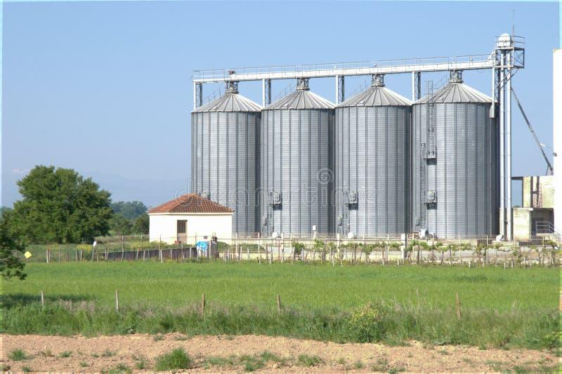 Grain silo plant unit dehydrate corps corn. Grain silo plant unit dehydrate agricultural store corps corn agricultural stock image