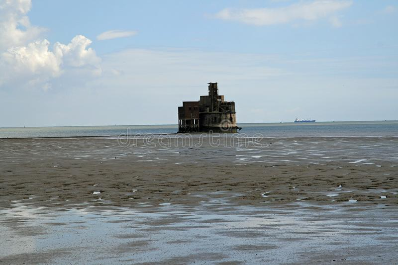 Grain Tower, Isle of Grain. Grain Tower is a mid-19th-century gun tower situated offshore just east of Grain, Kent, standing in the mouth of the River Medway. It royalty free stock photography