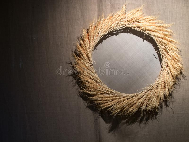 Grain Wreath Crown on Gray Fabric at Inside as Decorative Item. Grain Wreath Crown on Gray Fabric at Inside Decorative Item royalty free stock images
