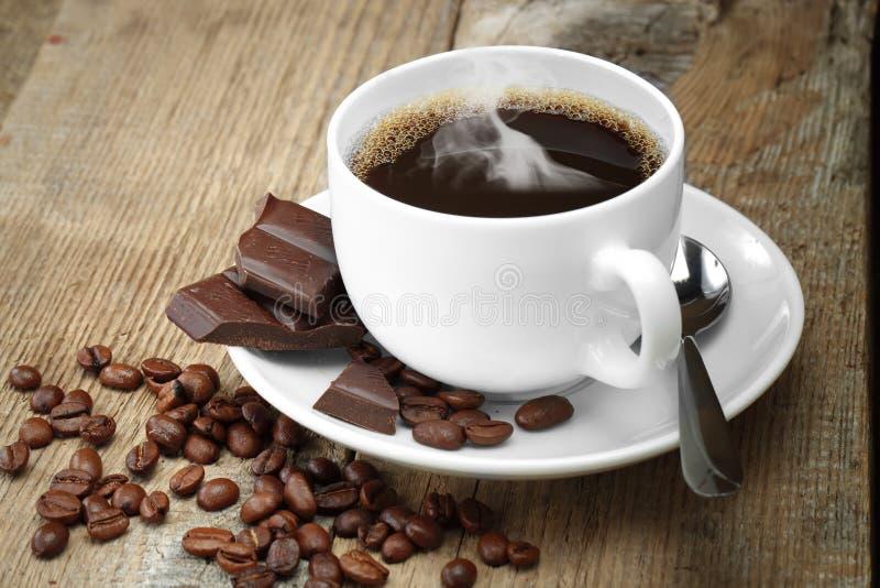 Graine de café noire photos libres de droits