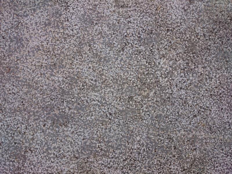 Grained stenbakgrundstextur Granit- eller betonggrå färgdotte fotografering för bildbyråer