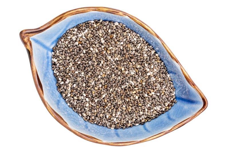 Graines de Chia dans la cuvette en céramique photographie stock