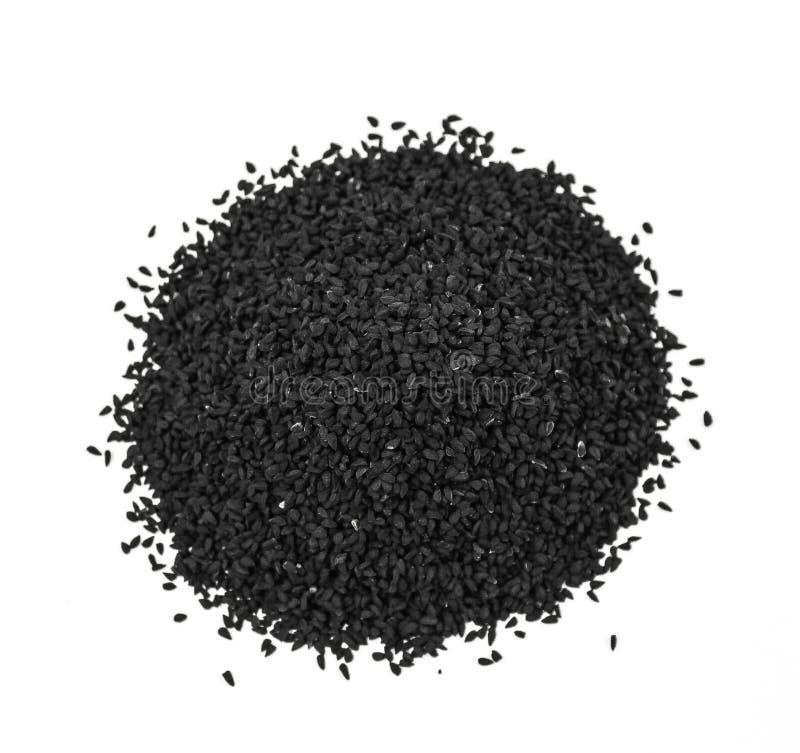 Graines de cumin noires images libres de droits