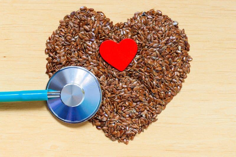 Download Graines De Lin Crues En Forme De Coeur Et Stéthoscope Image stock - Image du heartbeat, protection: 45361335
