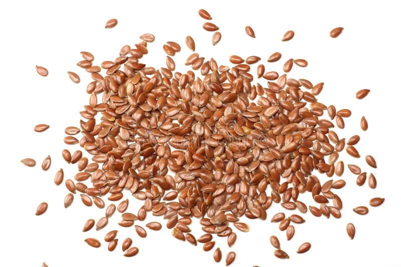 Graines de lin d'isolement sur le fond blanc semence d'oeillette ou lin oléagineux céréales Nourriture saine Vue supérieure photo stock