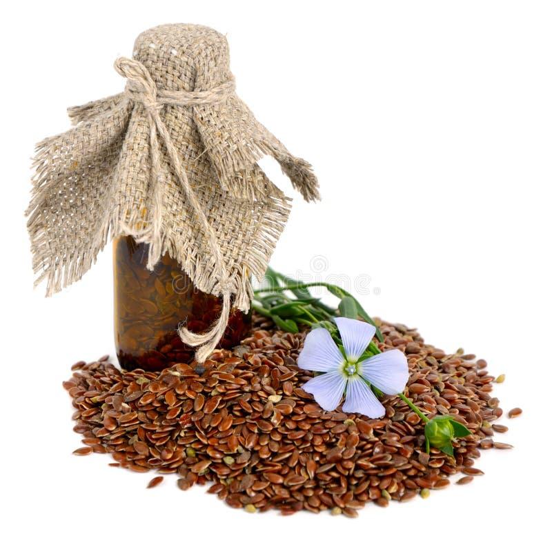 Graines de lin et fleurs. photographie stock libre de droits