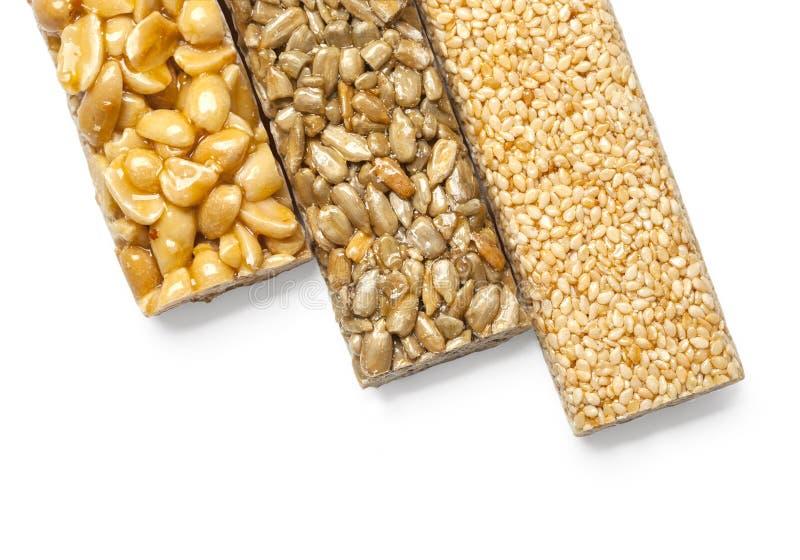 Graines de tournesol, sésame, arachides dans le syru de sucre photos libres de droits