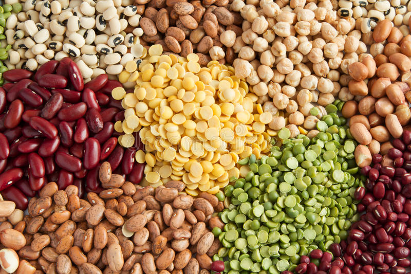 Grains beans legumes seed. Colorful different heap of grains legumes and beans seed top view royalty free stock images