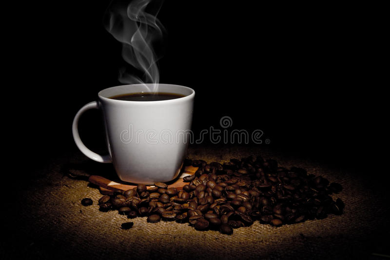Grains and cup of coffee royalty free stock photography