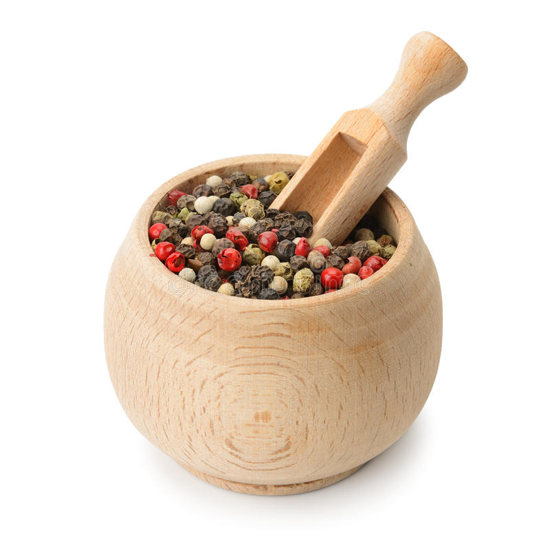 Grains pepper and wooden scoop in pot stock images