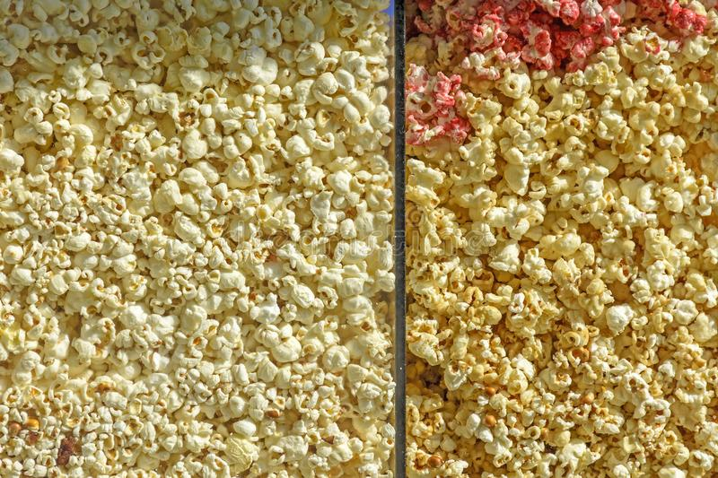 Grains of sweet and salty popcorn royalty free stock photography