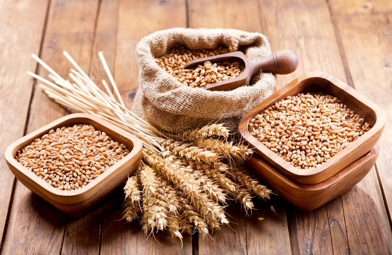 Grains and wheat ears on a wooden table stock photos