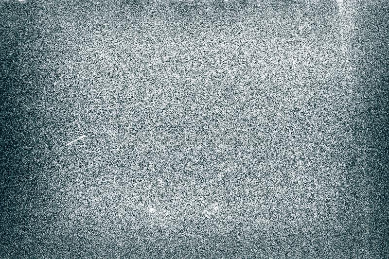 Grainy filmstrip background. Noisy old filmstrip texture background with heavy grain and dust royalty free stock image