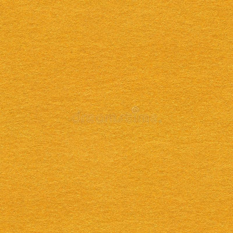 Grainy paper light orange background. Seamless square texture, t. Ile ready. High quality texture in extremely high resolution royalty free stock photography