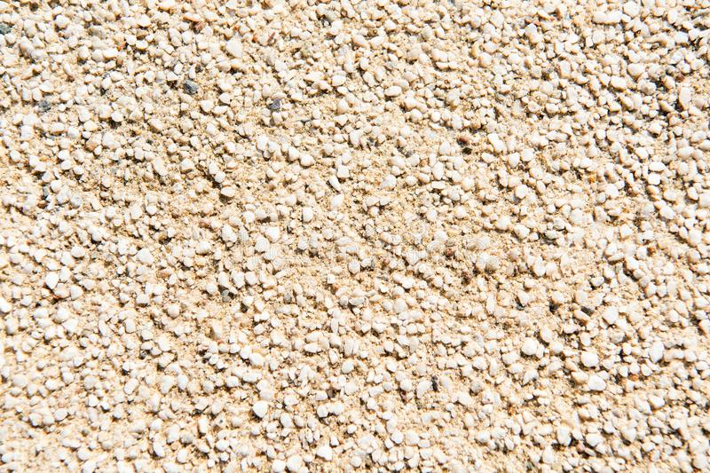 Grainy texture of decorative plaster. Tiny grains little stones in cement or concrete. Vintage decorations. Grainy wall royalty free stock image