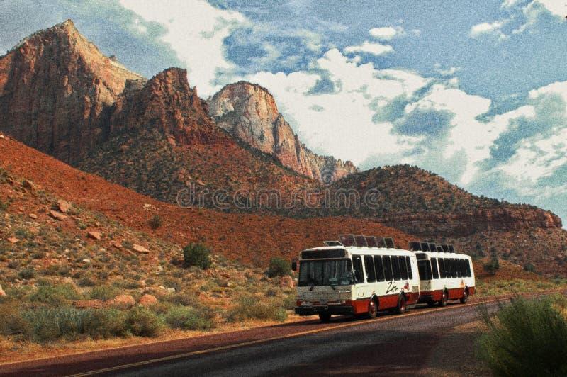 Grainy Tram against Red Rocks stock image