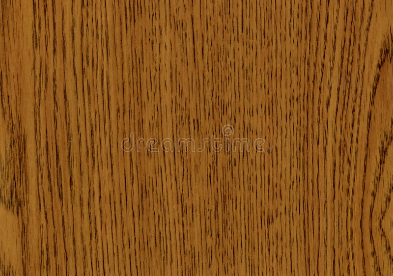 Grainy wooden oak background. Background of dark brown grainy wooden oak surface showing smooth texture royalty free stock images